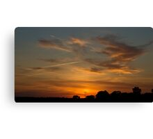 Charging the Sunset Canvas Print
