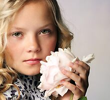 An adorable young girl holding a  pink peony by torishaa