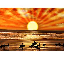 surfers walking on sunset beach Photographic Print