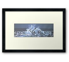 waves bursting onto rocks Framed Print