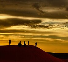 Sitting on the dock of a sand dune... by Ali Brown