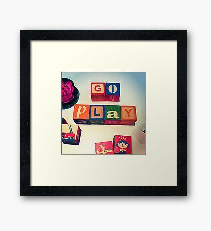Go Play Framed Print
