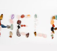 New age crystals and gemstones spelling out Help by PhotoStock-Isra