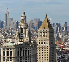 Aerial view of Manhattan buildings from Wall street building rooftop by Anton Oparin