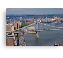 Aerial view to Manhattan bridge and city from Wall street building rooftop Canvas Print