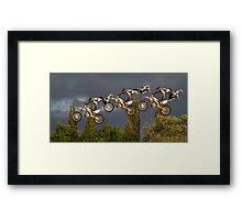 Composite of freestyle motocross 'superman' jump Framed Print