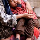 In Her Mother&#x27;s Arms, Fes Morocco by Debbie Pinard