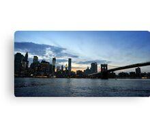New York City evening skyline with Brooklyn Bridge over Hudson River  Canvas Print