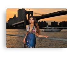 Beautiful girl posing at sunset time under Brooklyn Bridge, NYC Canvas Print