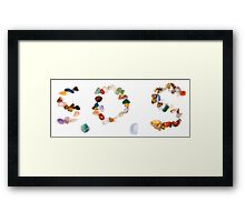 Spelling out S.O.S with stones the international rescue call Framed Print