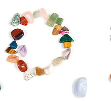 Spelling out S.O.S with stones the international rescue call by PhotoStock-Isra