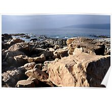 chile, lots of rocks at the bay, Poster