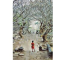Girl amoungst the trees in Wat Phu, Laos. Photographic Print