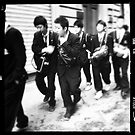 School boys from Japan walking the streets of Florence on an early Sunday morning by Ale Di Gangi