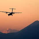 Airplane landing at sunset on the summer solstice by Ian Middleton