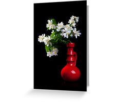 Jasmine bouquet in the vase on black background Greeting Card
