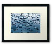 Pattern of water drops in a shining metallic surface with sky reflections Framed Print