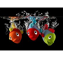 Three Toy Fish With Splash Photographic Print