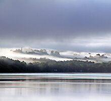 Early Morning Fog Lifting - Ottawa River by Debbie Pinard