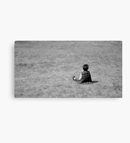 Boy on the lawn Canvas Print