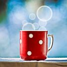 Red cup of coffee with smoke by michalbellan
