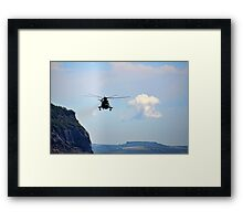 Helicopter Flying Over Charmouth Framed Print