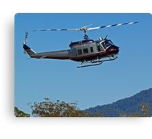 Huey Helicopter in motion Canvas Print