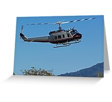 Huey Helicopter in motion Greeting Card