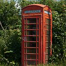 Traditional red telephone box by picsl8