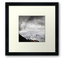 Snowy Mount Everest shines through the clouds Framed Print