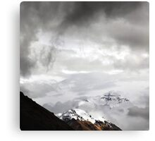 Snowy Mount Everest shines through the clouds Canvas Print