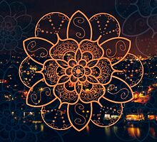 Orange mandala flower on tilt-shifted Gold Coast night lights photo by faithie