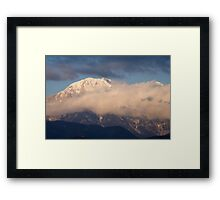 In the shadow of the mountain peak Framed Print