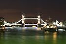 Tower Bridge and HMS Belfast at night by Jasna
