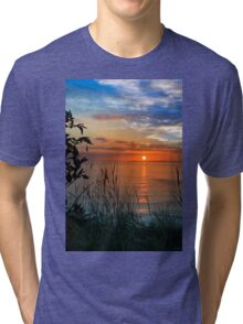 sunset over loop head with silhouetted wild tall grass  Tri-blend T-Shirt