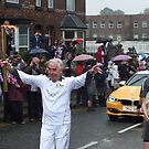 Joe Beswick proudly carries the Olympic Torch through Macclesfield by Matt Eagles