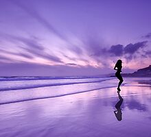 Reflections of a girl on the beach at sunset. by Andy Fox