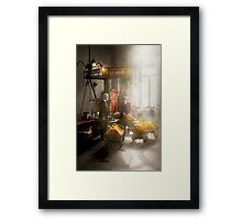 Banker - Worth its weight in gold Framed Print