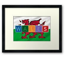 wales and flag in toy block letters Framed Print