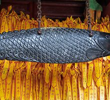 Lots of little prayer ribbons - and a temple fish by Marjolein Katsma