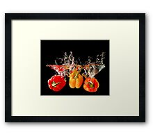 A Splash Of Peppers Framed Print