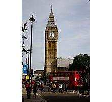 A bus crosses the intersection in front of Big Ben Photographic Print