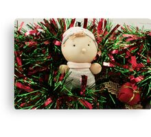 A handmade baby doll in tinsel Canvas Print