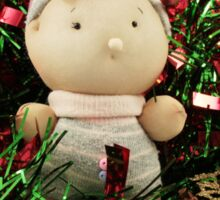 A handmade baby doll in tinsel Sticker