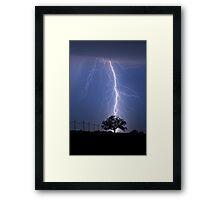 Lightning Bolts Striking Behind Tree Framed Print