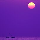sunrise over a lonely fisherman by irenaeus herwindo