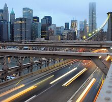 Evening rush-hour on the Brooklyn Bridge by Roger  Mackertich