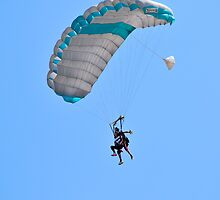 Tandem paragliding Instructor and trainee tied together during the jump.  by PhotoStock-Isra