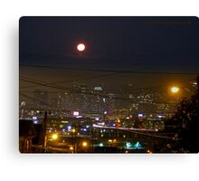 City Lights and the Moon Canvas Print
