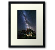 The Milky Way that rises among the houses Framed Print